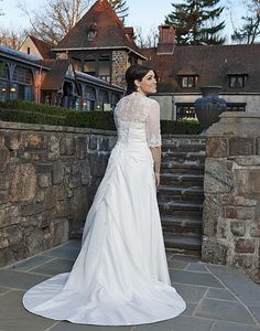 Wedding dress ( Bridal gown) Sincerity   Style 4559: Taffeta A-line dress accentuated with a modified sweetheart neckline | Sincerity Bridal Plus.Shown in All Ivory A modified sweetheart neckline accented with beaded lace appliques, on a taffeta asymmetrical A-line skirt. This style has a corset back with a detachable chapel length train, and comes with a beaded lace and tulle 3 quarter length bolero. Available colors : All Ivory, White