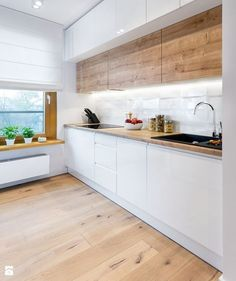 a minimalist Scandi kitchen with wooden upper cabinets, sleek white lower ones, . a minimalist Scandi kitchen with wooden upper cabinets, sleek white lower ones, a windowsill shelf Simple Kitchen Cabinets, Simple Kitchen Design, Best Kitchen Designs, Interior Design Kitchen, Island Kitchen, Modern Kitchen Cupboards, Soapstone Kitchen, Kitchen Peninsula, Kitchen Counters