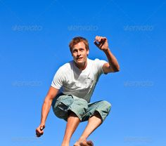 Portrait of a handsome Man jumping in the air outdoor ...  adult, arms, beautiful, beauty, blue, close, country, countryside, dad, day, family, father, free, fun, gesture, hands, happy, head, holiday, joy, joyful, kid, life, lifestyle, love, male, man, man caucasian, moves, nature, outdoor, parent, park, people, person, play, relax, sky, smile, son, summer, sunny, together, two, young