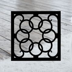 This decorative Wrought Iron Wall Art piece, Style 214, features a Geometric square silhouette that will add beauty and character to any wall or surface. It is coated in one of the most long-lasting finishes available - a flat black baked-on powder coated finish that will last for many years.