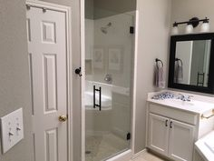 Frameless inline shower with stationary panel and door that swings in and out, Ladder pull handle, finish in Oil Rubbed Bronze Frameless Shower Enclosures, Inline, Swings, Oil Rubbed Bronze, Double Vanity, Ladder, Stationary, Handle, Mirror