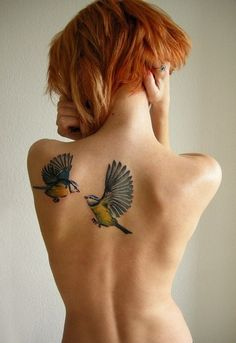Beautiful! birds in flight--lovely tattoo. Placement is nice too.