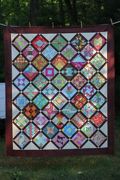 I love the brown framing out all the blocks!       Farmer's Wife Quilt Top by twinfibers, via Flickr