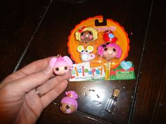 Lalaloopsy necklaces using pencil topper packs. Necklace attachment found at local crafting store.