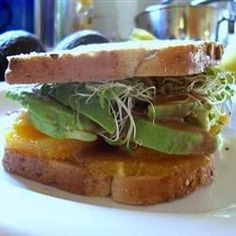"""Avocado and Orange Sandwich   """"This was a surprisingly delicious combination! I used kale instead of alfalfa sprouts for extra healthiness, and it tasted great."""""""