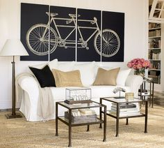 My sister-in-law is moving into a studio next month and she asked me to help her decorate. I am on a mission to find some nice fabric to stretch over canvas to make her some art. Although the the bike isn't her style, this is the look I am going for.
