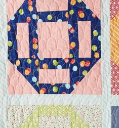 Camille Roskelley machine-quilted a scallop design across the quilt top.