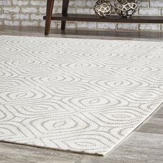 Bring a hint of the exotic to your décor with the Rhea Rug. A Moroccan-inspired ogee print creates an eye-catching illusion, while versatile hues make the look adaptable to any space. Woven polyester promises lasting quality and easy maintenance.