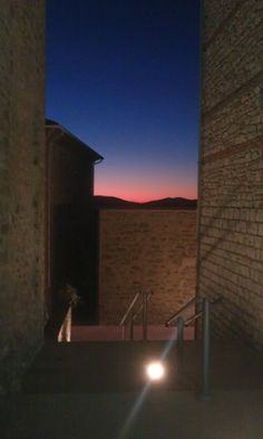 sunset through the alleys of the village of Preggio, Umbria Stone Walls, Sunset, Reading, Places, Interior, Books, Libros, Paredes De Piedra, Indoor