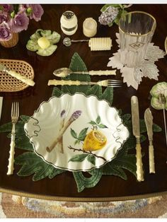 What makes this tablescape so wonderful are the placement that perfectly mimics the leaves on the dish, the leaf shape of the coaster and the side dishes, the bamboo handled utensils, and a nice bouquet of flowers.  So pretty it almost doesn't need food on it.