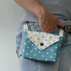 How cute! This little bag hangs off of your belt loops (it could be nice if I'm wearing a dress/skirt with belt loops). It could be handy for something like a camera or even small change when you're going garage saling and you don't want your purse getting in the way.