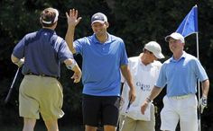 Dallas Cowboys quarterback Tony Romo jokes with his group after sinking a gimme putt on the 13th green at the Dallas Cowboys annual golf tournament at Cowboys Golf Club in Grapevine on Wednesday, May 9, 2012.