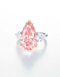 This 9.38ct Fancy Intense pink pear-shaped diamond and diamond ring has an estimate of US$5.8-8.3 million).