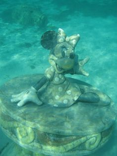 Minnie at Castaway Cay snorkel area. What?? I must find her when we go on that cruise!!!