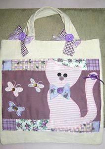 Bolsa com patchwork e aplique de gatinho