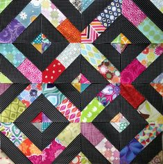 Great scrappy quilt! Love the brights with black