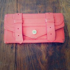"""Proenza Schouler PS1 Continental Wallet Beautiful Coral Proenza Schouler PS1 Continental Wallet! Retails for $585. This wallet has been loved and could use repair, low price reflects condition. I used this daily for 6 months. If you take it to a leather repair store they can touch up the color.  Size 7.5""""x4""""x1"""" Proenza Schouler Bags Wallets"""