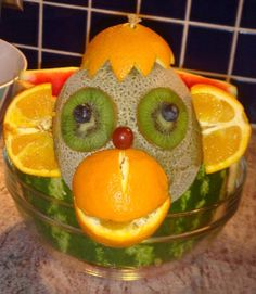 This decorates the edge of a fruit bowl.  The monkey is made entirely of fruit.