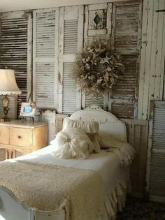 wall of shutters and lace embroidered linens