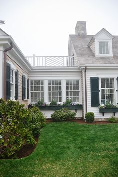 Details - HGTV Dream home: window boxes, upstairs deck, materials and colors.