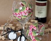 Hand painted wine glass in a magenta pink wrap around floral design. Dishwasher safe