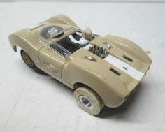 http://www.ebay.com/itm/Vintage-1960s-Aurora-Thunderjet-1397-Tan-McLaren-Elva-Slot-Car-No-Reserve/191776777784?_trksid=p2047675.c100005.m1851