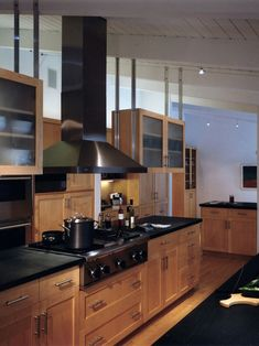 Birch Kitchen Cabinets ...pops with the dark countertops and stainless pulls