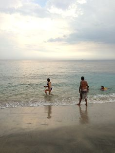 The Candidasa white sand beach is becoming more popular for family. Photo by Indra Febriansyah.