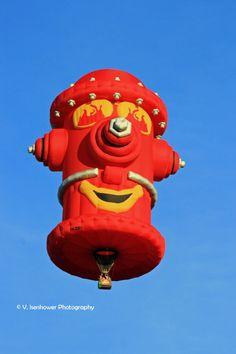A fire hydrant special shape balloon at the Albuquerque International Balloon fiesta.