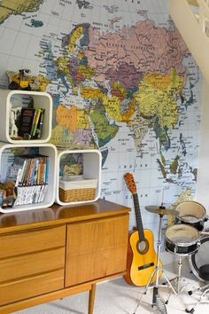 One wall, have a big map mural. Ben's room. And add details like - where Spiderman hangs out (NY) and find Gotham City. Where the Snow Leopard is that we adopted, places we have been on holiday etc.