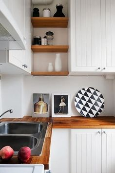 """Open shelving: love it or hate it? We asked, and you answered — and a lot of you really hate open shelving. Others really love it, and most fall in between, in the """"open shelving is beautiful, but I'd really love a few cabinets to hide the ugly dishes in"""" camp. So we've gathered some inspiration for all your happy medium-ers: a whole bunch of beautiful kitchens that combine open shelving and closed upper cabinets, beautifully."""