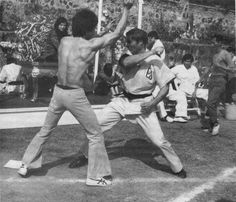 Bruce Lee with John Saxon, behind the scenes of Enter the dragon