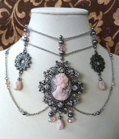 Not my ideal colors, but the idea is superb. Pretty!    Pink and gray cameo necklaces choker with glass by TheAtticAngel, $37.00