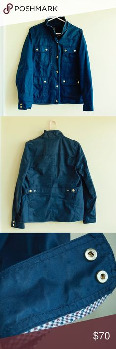 J Crew Downtown Field Jacket The quintessential cool-girl jacket (aka every girl needs one). In waxed cotton with military-inspired pockets and snaps, this is our idea of standard issue. This jacket is navy blue and has role up sleeves with great detailing.   Standing collar. Adjustable waist tabs. Chest pockets, hip pockets. J. Crew Jackets & Coats Utility Jackets