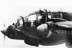 A forward machine gunner sits at his battle position in the nose of a German Heinkel He 111 bomber, while en route to England in November of 1940. (AP Photo)