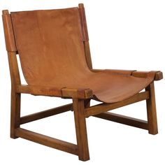 For Sale on - Hunting chair by Paco Muñoz in beautiful condition. This low lounge chair has a rustic solid oak frame. The thick cognac colored leather is loosely attached Swivel Armchair, Modern Armchair, Modern Chairs, Modern Furniture, Modern Lounge, Furniture Design, Leather Lounge, Leather Chairs, Oak Color