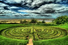 Julian's Bower, Lincolnshire, UK is a unicursal turf maze or labyrinth. It is thought that it was constructed in Roman times as part of a game but some people think that it was cut out by monks in the 12th century. It was used by the Medieval Church for some sort of penitential purpose and only reverted to it's former use as an amusement or diversion after the Reformation