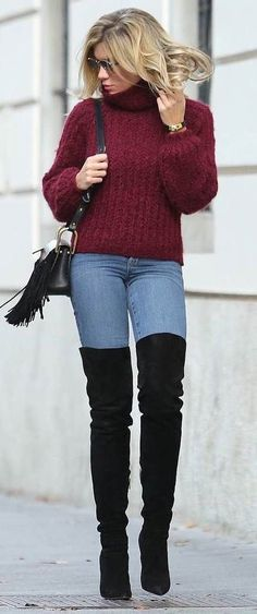 Burgundy sweater with blue jeans And black OTK boots.
