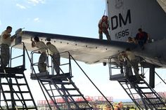 Airmen from the 755th Aircraft Maintenance Squadron work together to remove the panel on the right horizontal stabilizer of an EC-130H Compass Call at Davis-Monthan Air Force Base, Ariz., Aug. 30, 2016. The 755th AMXS plans and executes all equipment maintenance actions for 14 EC-130Hs. (U.S. Air Force photo/Senior Airman Betty R. Chevalier)