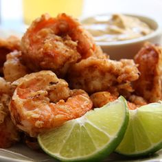 Marinated in chili-spiked buttermilk overnight before being dipped in Cajun-seasoned flour and deep fried, these crunchy shrimp get extra kick from chipotle/cilantro/lime dipping sauce.