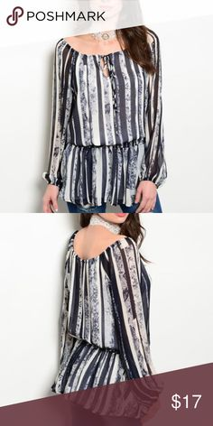 Navy and white blouse top This chiffon top features a boat neckline, tribal print all over and dropped gathered waist. Honey Punch Tops Blouses
