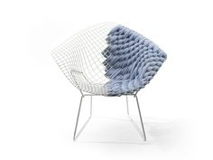 Fans of Harry Bertoia's signature metal gridwork will most likely be enthralled with the Bertoia Loom Chair, a reinterpretation of the classic design by French designer Clément Brazille. Even those wary of the chair's lack of cushioning may be sed.