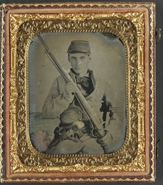 (c. 1861-1865) Soldier in Confederate infantry uniform with musket and brass framed revolver.