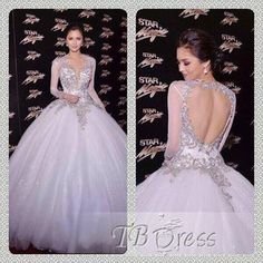 not very often you see a pretty ball gown with full length sleeves and open back. very pretty beaded detailing