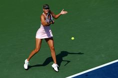 Maria Sharapova of Russia returns a shot during her women's singles semifinal match against Victoria Azarenka of Belarus on Day Twelve of the 2012 US Open