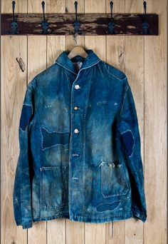 Worn, patched and repaired indigo blue denim jean jacket | Old | Holes | Mending