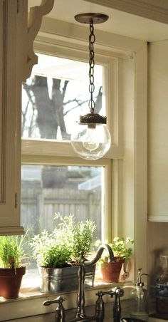 vintage lighting & view. I would love to have this in my own kitchen some day!