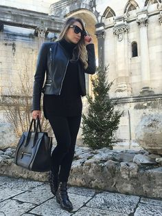 Get this look: http://lb.nu/look/7970192  More looks by Sonja Kovac: http://lb.nu/xoxosonja  Items in this look:  Dkny Leather Jacket, Choies Sweater, Celine  Bag, Frame Denim Black Skinny Jeans, Jonak Paris Ankle Boots, Celine Sunglasses   #casual #chic #street #black #allblack #leatherjacket #zara #sweater #choies