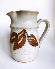 studio pottery leaf pitcher  https://www.etsy.com/listing/537900369/studio-pottery-leaf-pitcher