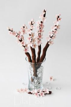 Cherry blossom cookies. Maybe use a pretzel dipped in chocolate and fondant or frosting for the flowers?